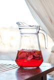 Jug of fresh red fruit drink Royalty Free Stock Images