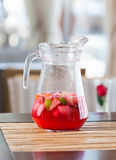 Jug of fresh red fruit drink Royalty Free Stock Photo