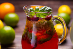 Jug of freshness lemonade with strawberries and cranberry. Royalty Free Stock Photography