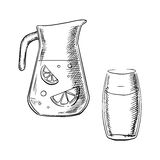 Jug and glass with fresh lemonade Stock Images