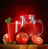 Jug and glass full of tomato juice. Royalty Free Stock Photo