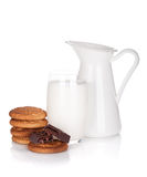 Jug and glass of milk, cookies and chocolate Royalty Free Stock Photography