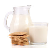 Jug and glass of milk with stack of grain crispbreads isolated on white background Royalty Free Stock Image