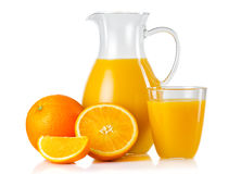 Jug and glass with orange juice and fruits with slices isolated Royalty Free Stock Photo
