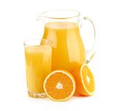 Jug, glass of orange juice and orange fruits Stock Images