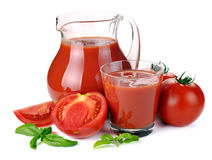 Jug, glass of tomato juice and fruits Royalty Free Stock Photography