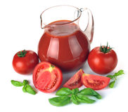 Jug, glass of tomato juice and fruits Royalty Free Stock Photos
