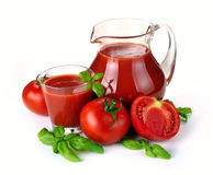Jug, glass of tomato juice and fruits Royalty Free Stock Image