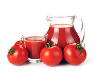Jug, glass of tomato juice and fruits Royalty Free Stock Images