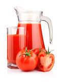 Jug and glass of tomato juice with fruits isolated Royalty Free Stock Images