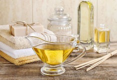 Jug of golden liquid soap in the bathroom Royalty Free Stock Photography