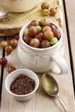 Jug of gooseberry fruits and bowl of gooseberry jam Royalty Free Stock Image
