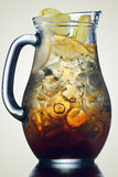 Jug of ice tea. Iced tea in the pitcher. A jug of cold tea. Low key image Stock Photos