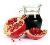 Jug of juice and ripe piece grenade Royalty Free Stock Photos