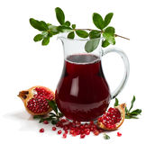 Jug of juice and ripe piece pomegranate Stock Photo
