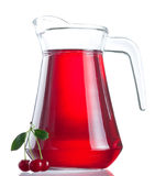 Jug of juice and three ripe cherries Stock Photography