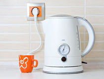 Jug kettle and cup Royalty Free Stock Photo