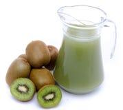 Jug of kiwi juice and some fresh kiwis. Isolated on white Stock Photos