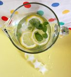 Jug of lemonade. Lemonade with mint and star shaped ice cube stock images