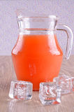 Jug with liquid Stock Photography
