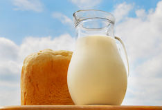 Jug with milk, bread Royalty Free Stock Photography