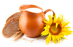 Jug with milk and bread Stock Image