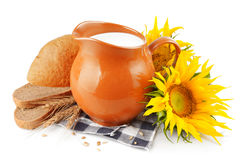 Jug with milk and bread Stock Photography
