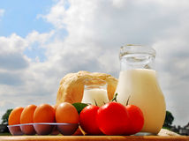Jug with milk, bread and eggs Stock Photos