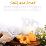 Jug with milk, bread on a white b Royalty Free Stock Image