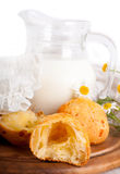 Jug with milk, bread and wild flowers Stock Photo