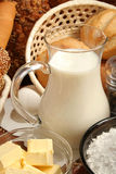 Jug of milk, butter and flour stock photo