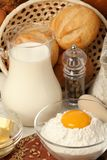 Jug of milk, butter and flour Stock Photography