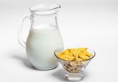 Jug of milk and corn flakes. Jug with milk and corn flakes on a white background, healthy food Royalty Free Stock Photos