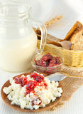 Jug with milk and cottage cheese Royalty Free Stock Photos