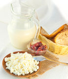 Jug with milk, cottage cheese and jam Royalty Free Stock Images