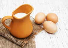 Jug with milk and eggs Royalty Free Stock Photos