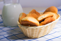 Jug of milk and fresh rolls for breakfast Royalty Free Stock Photos