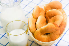 Jug of milk and fresh rolls for breakfast Stock Photography