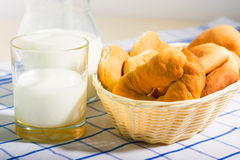 Jug of milk and fresh rolls for breakfast Stock Images