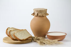 Jug of milk with freshly baked white bread and wheat ears. Milk Royalty Free Stock Image