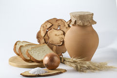 Jug of milk with freshly baked white bread and wheat ears. Tree Stock Photo