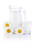 Jug milk, glass and three chamomile flowers Royalty Free Stock Photos
