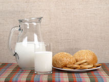 Jug with milk and loaves Royalty Free Stock Photos