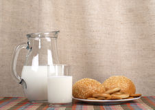 Jug with milk and loaves Stock Photos