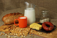 Jug with a milk mug, cheese and sausage Royalty Free Stock Images