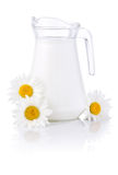 Jug milk and three chamomile flowers  Stock Photos