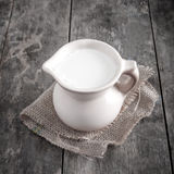 Jug with milk. On wooden background, close up Stock Photography