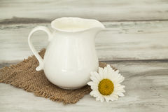 Jug of milk on wooden table Stock Image