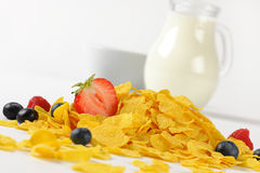 Jug og milk and corn flakes with fruits Royalty Free Stock Photos