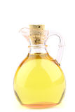 Jug of oil. Little jug of oil over white background Stock Image